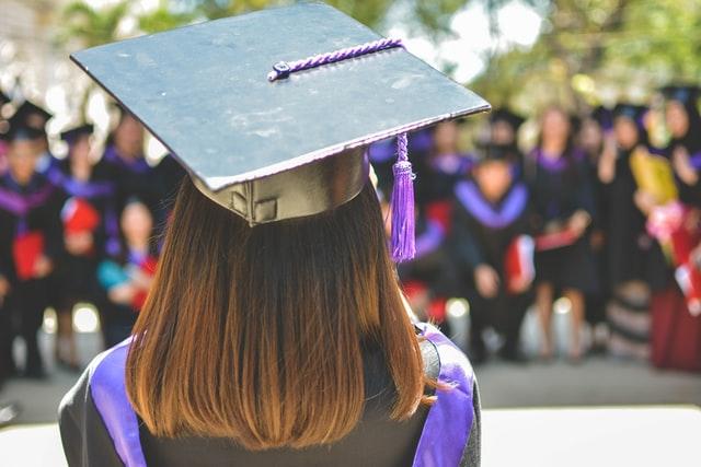 student with graduation cap
